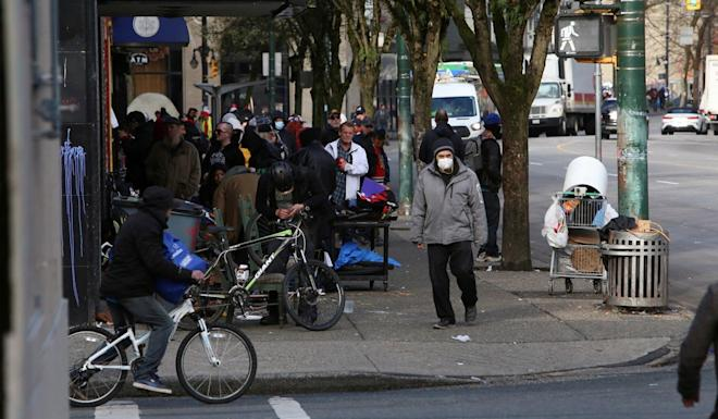 Residents of the Downtown Eastside in Vancouver, British Columbia, on Wednesday. Photo: Reuters