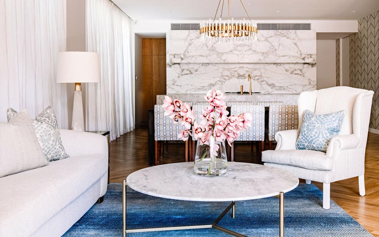 """<p><a href=""""https://www.housebeautiful.com/room-decorating/colors/g825/blue-rooms/"""" target=""""_blank"""">Blue</a> is everyone's favorite <a href=""""https://www.housebeautiful.com/color-schemes/"""" target=""""_blank"""">color</a> for a reason—and if you're thinking <em>umm, no, it's not mine, </em>it's still hard to deny its timeless beauty, especially when it comes to interior design. Evocative of the open sky and calming sea and the source of some of the greatest <a href=""""https://www.housebeautiful.com/room-decorating/colors/g15954761/color-quotes/"""" target=""""_blank"""">literary</a> and visual <a href=""""https://www.housebeautiful.com/home-remodeling/renovation/a29952272/moma-farrow-and-ball-renovation/"""" target=""""_blank"""">art</a> works in history (Yves Kleins' signature shade and Maggie Nelson's <em>Bluets,</em> we're looking at you), blue is one of those pigments that instantly calms the senses and fills any space with beauty. Not to mention, it goes with just about every other color and design trend, from stark minimalist environments to <a href=""""https://www.housebeautiful.com/room-decorating/colors/g31485503/off-white-paint-color-ideas/"""" target=""""_blank"""">warm</a> and <a href=""""https://www.housebeautiful.com/room-decorating/colors/g30719226/tropical-colors/"""" target=""""_blank"""">vibrant</a> backdrops. So whether it's the main act or a supporting character in your home, we rounded up fourteen rooms with colors that go with blue to pave the way.  Keep reading for plenty of inspiration and blue color palettes to experiment with.</p>"""