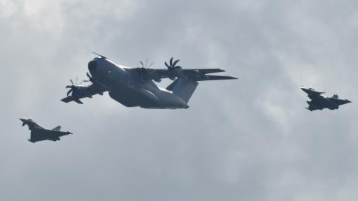 A giant Airbus A400M military transport aircraft flanked by Eurofighters goes through its paces, the fruit of a major European defence cooperation effort
