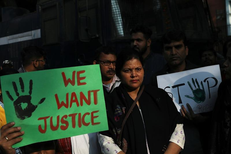 People hold placards and shout slogans as they take part in a protest against the alleged rape and murder of a 27-year-old woman on the outskirts of Hyderabad, in New Delhi, India, November 30, 2019. (Photo by REUTERS/Anushree Fadnavis)