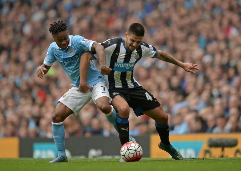 Manchester City's Raheem Sterling (L) fights for the ball with Newcastle United's Aleksandar Mitrovic during their English Premier League match, at the Etihad Stadium in Manchester, on October 3, 2015