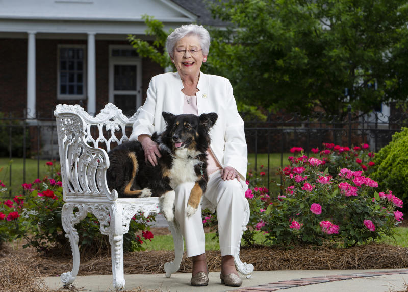 "This photo provided by the Office of Alabama Gov. Kay Ivey, shows Ivey and her dog Missy. Ivey fractured her shoulder after being tripped by the state's ""first dog,"" her office said Wednesday, Jan. 29, 2020. The rescue pooch unintentionally tripped the governor at home Tuesday night, Ivey's office said. (Hal Yeager/Office of Alabama Gov. Kay Ivey via AP)"