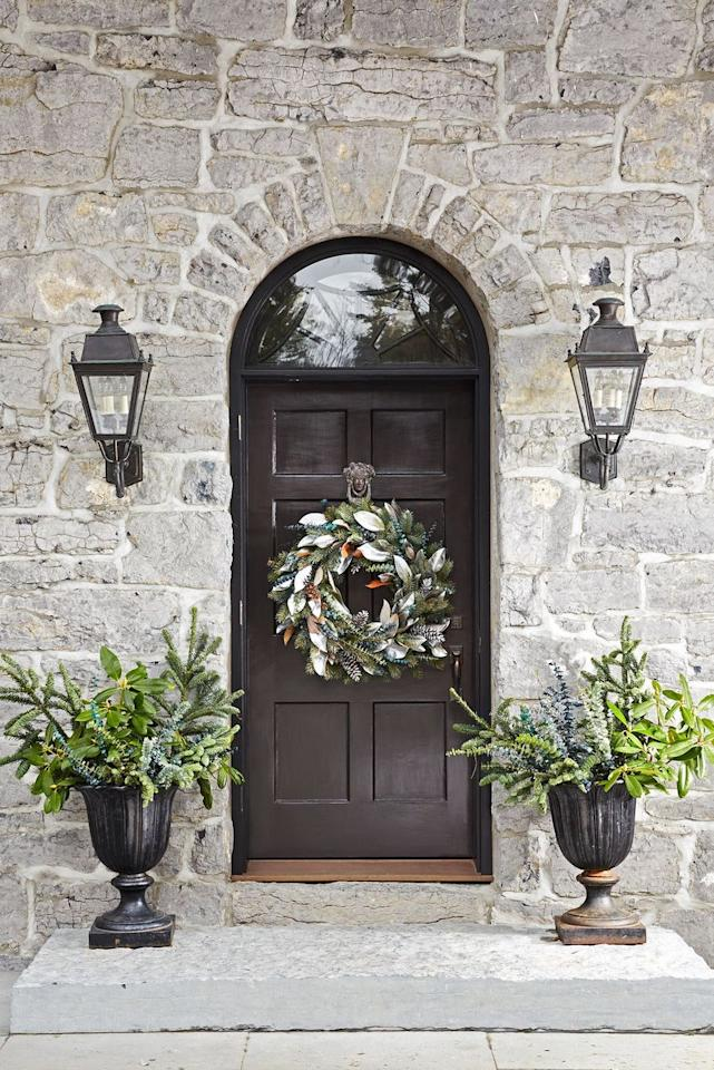 """<p>Hanging up a wreath is the best way to give your front porch a little fall flair. And it's super easy. Go all out with a harvest wreath or keep it understated with an elevated seasonal wreath like this one and hang it below your knocker. <a href=""""https://www.housebeautiful.com/room-decorating/outdoor-ideas/g853/outdoor-room-design-ideas/"""" target=""""_blank""""></a></p>"""