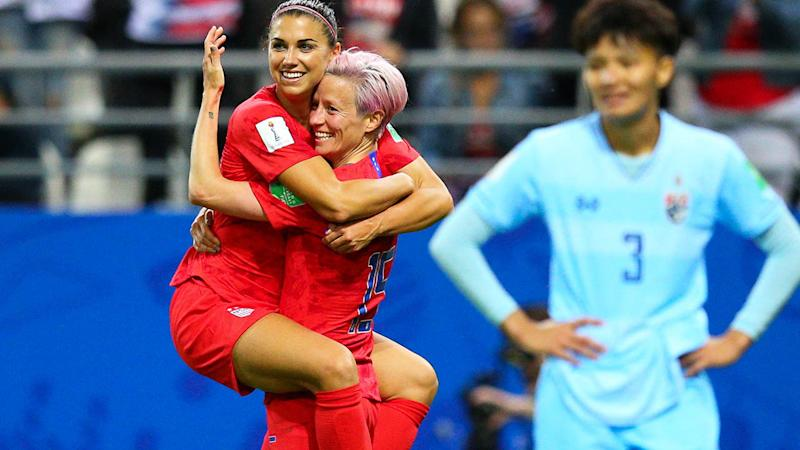Alex Morgan celebrates with teammate Megan Rapinoe. (Photo by Craig Mercer/MB Media/Getty Images)