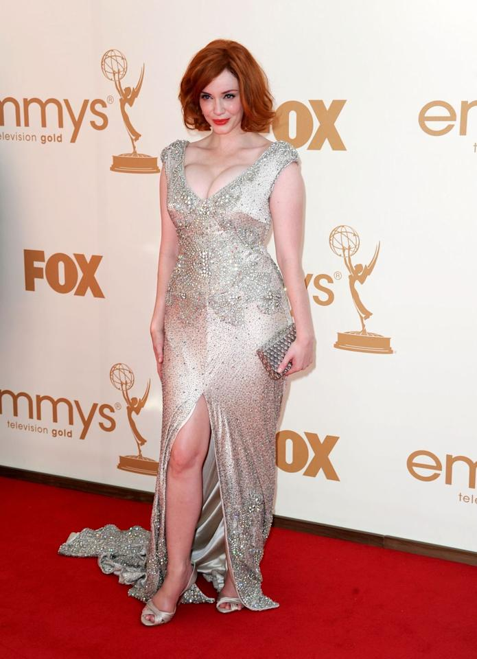 <p>The <em>Mad Men</em> star showed off her bombshell curves in this sparkling Joanna Johnson dress at the 2011 ceremony. </p>