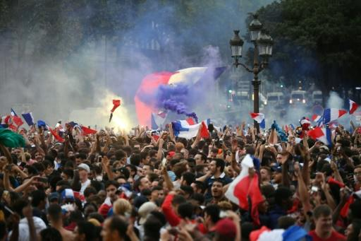 Fans, fares and flags at the Hotel de Ville in Paris to mark France's win over Belgium