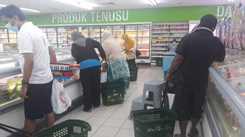 Shoppers at the frozen food section at the Giant supermarket in Ampang. Photo: Coconuts