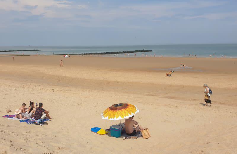 People sunbathe on a beach during the coronavirus disease (COVID-19) outbreak, in Knokke-Heist