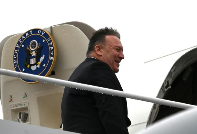US Secretary of State Mike Pompeo boards his plane at Andrews Air Force Base en route to Munich on a trip that will include his first tour of sub-Saharan Africa