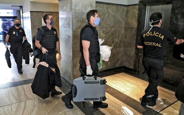 Federal police officers, pictured here carrying seized evidence, raided the residence of the governor of Rio de Janeiro, Wilson Witzel, as part of an anti-corruption investigation