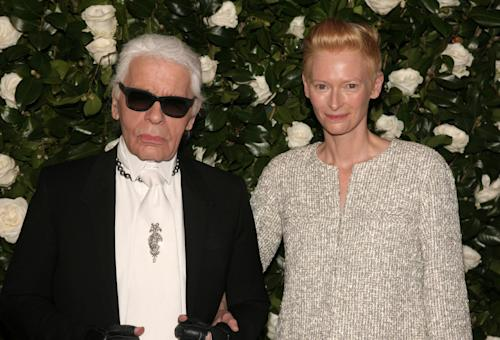 Fashion designer Karl Lagerfeld, left, and actress Tilda Swinton, attend the the Museum of Modern Art Film Benefit on Tuesday, Nov. 5, 2013, in New York. (Photo by Andy Kropa/Invision/AP)