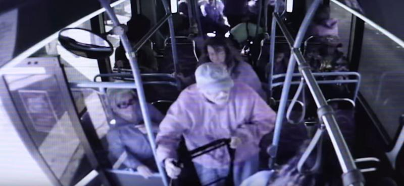 The elderly man picks up his walker as he tries to step off a bus in Las Vegas.