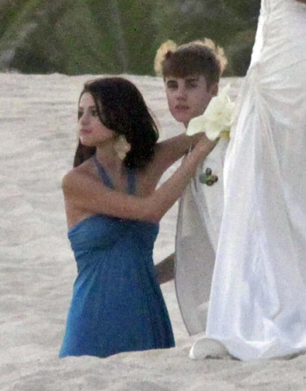 Justin Bieber and Selena Gomez at Shannon Larossi wedding, the wedding was on the beach at Los Cabos, Mexico