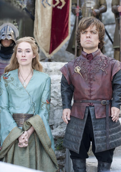 "FILE - In this publicity file photo provided by HBO, Lena Headey as Cersei Lannister, left, and Peter Dinklage as Tyrion Lannister, are shown in a scene from HBO's ""Game of Thrones."" The program was nominated for an Emmy award for outstanding drama series on Thursday, July 19, 2012. The 64th annual Primetime Emmy Awards will be presented Sept. 23 at the Nokia Theatre in Los Angeles, hosted by Jimmy Kimmel and airing live on ABC. (AP Photo/HBO, Paul Schiraldi, File)"