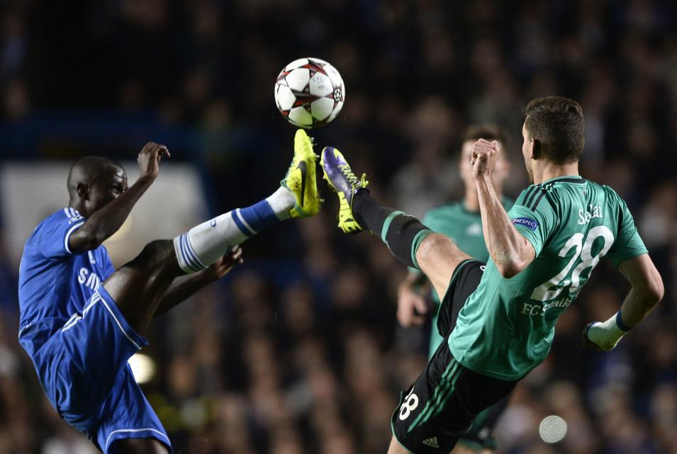 FC Schalke 04's Szalai is challenged by Chelsea's Ramires during their Champions League soccer match at Stamford Bridge in London