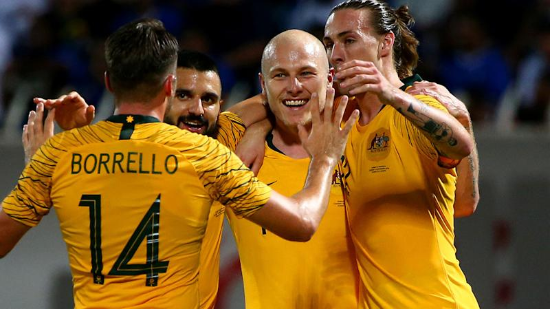 The Socceroos, pictured here celebrating their win over Kuwait.