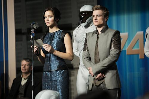 "This publicity photo released by Lionsgate shows Jennifer Lawrence, left, as Katniss Everdeen and Josh Hutcherson as Peeta Mellark in a scene from the film, ""The Hunger Games: Catching Fire."" The movie opens in theaters Friday, Nov. 22, 2013, in what's expected to be one of the year's biggest box-office debuts. (AP Photo/Lionsgate, Murray Close)"