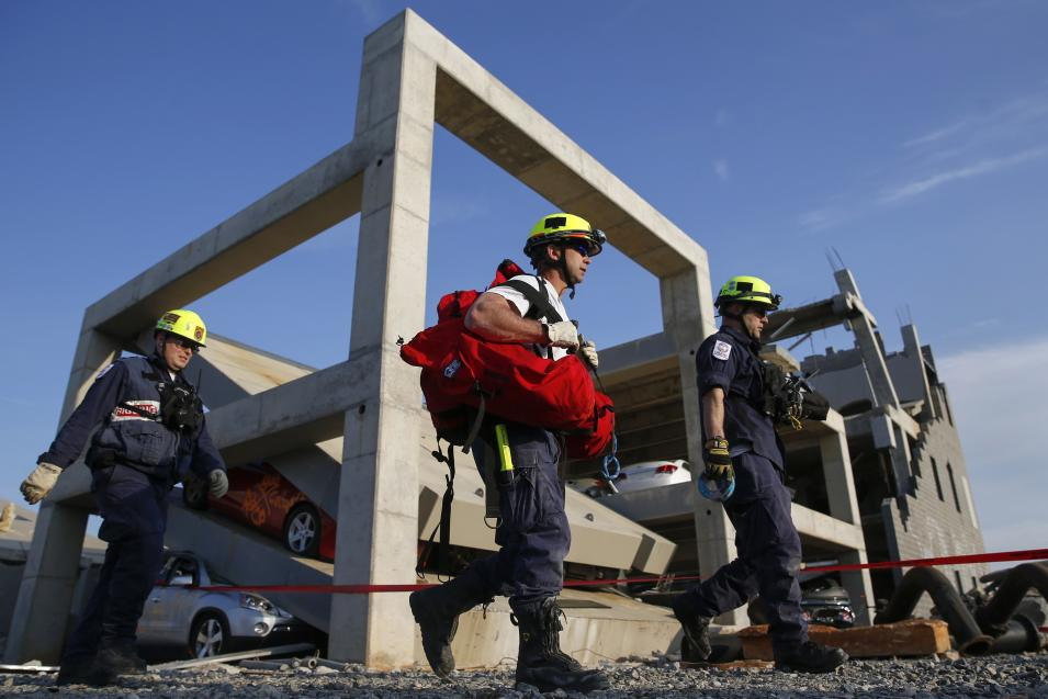 Rescue specialists for USA-1 leave the scene of a mock disaster area during a training exercise at the Guardian Center in Perry
