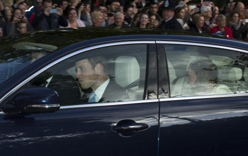 Britain's Prince William, left, and his wife Kate the Duchess of Cambridge, right, arrive for the Christening of their son Prince George at St James's Palace in London, Wednesday, Oct. 23, 2013. (AP Photo/Matt Dunham)