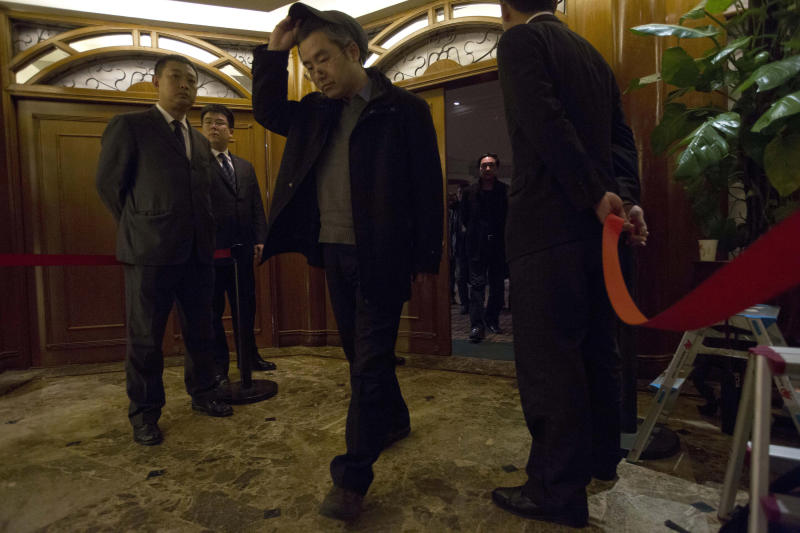 A man walks out of a room reserved for relatives of Chinese passengers aboard missing Malaysia Airlines flight MH370 at a hotel in Beijing, China, Saturday, March 15, 2014. Investigators have concluded that one or more people with significant flying experience hijacked the missing Malaysia Airlines jet, switched off communication devices and steered it off-course, a Malaysian government official involved in the investigation said Saturday. (AP Photo/Ng Han Guan)