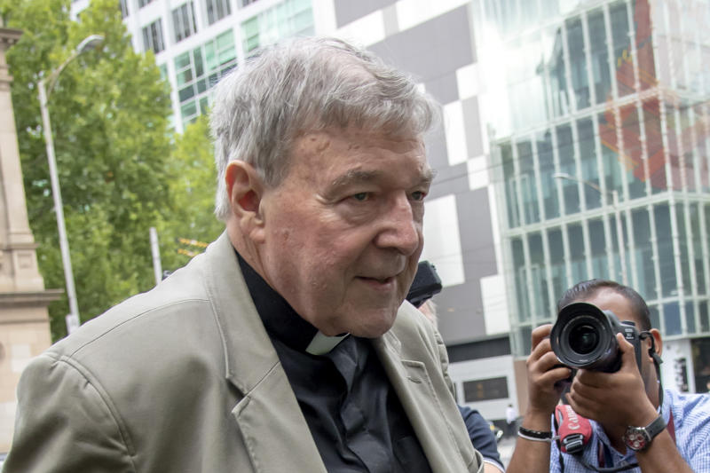 In this Feb. 26, 2019, photo, Cardinal George Pell leaves the County Court in Melbourne, Australia. Australia's highest court on Tuesday, April 7, 2020 will judge Pell's appeal against convictions for molesting two teenage choirboys more than two decades ago. But the legal battle over the world's most senior Catholic convicted of sexually abusing children may not end there. (AP Photo/Andy Brownbill)