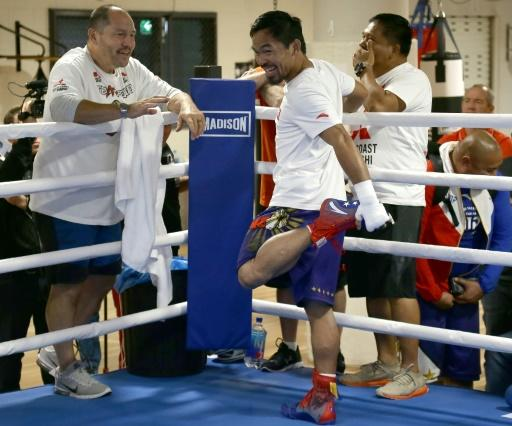 Manny Pacquiao's conditioning coach, Justin Fortune (L) is a former heavyweight who fought off throat cancer