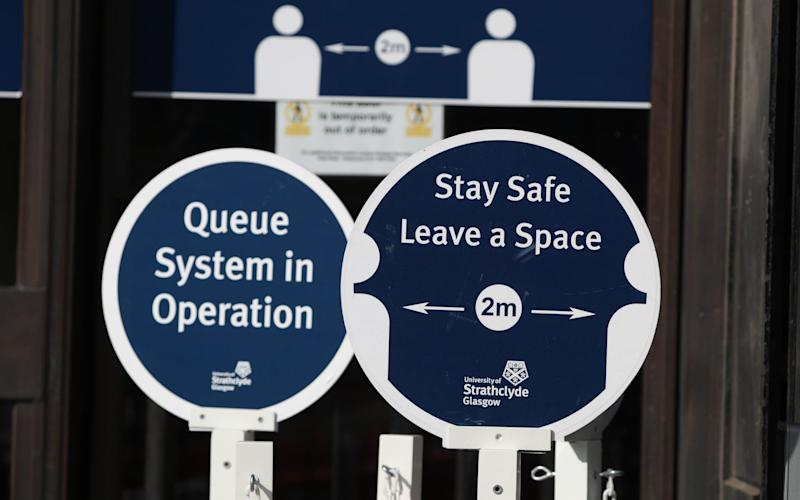 Social distancing signage in place at the entrance to the University of Strathclyde, Glasgow -  Andrew Milligan/PA