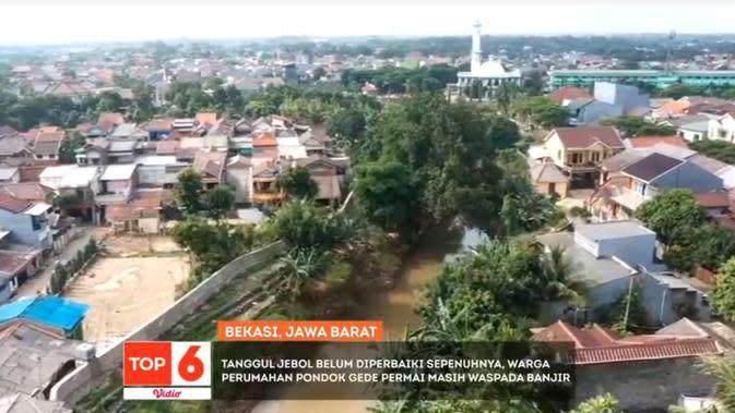 Perbaikan Tanggul Belum Selesai, Warga Pondok Gede Permai Waspada Banjir