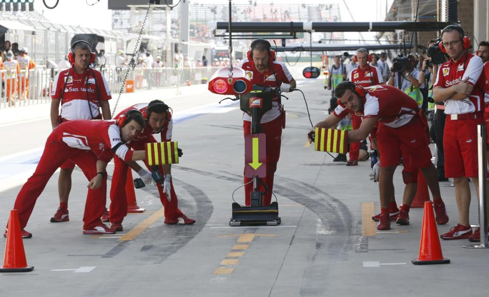 Pit crew wait for Ferrari Formula One driver Massa during the third practice session of the Korean F1 Grand Prix in Yeongam