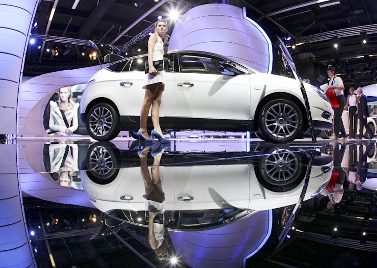 A Lancia Delta is mirrored in the floor at the 64th Frankfurt Auto Show in Frankfurt, Germany, Wednesday, Sept.14, 2011. (AP Photo/Michael Probst)