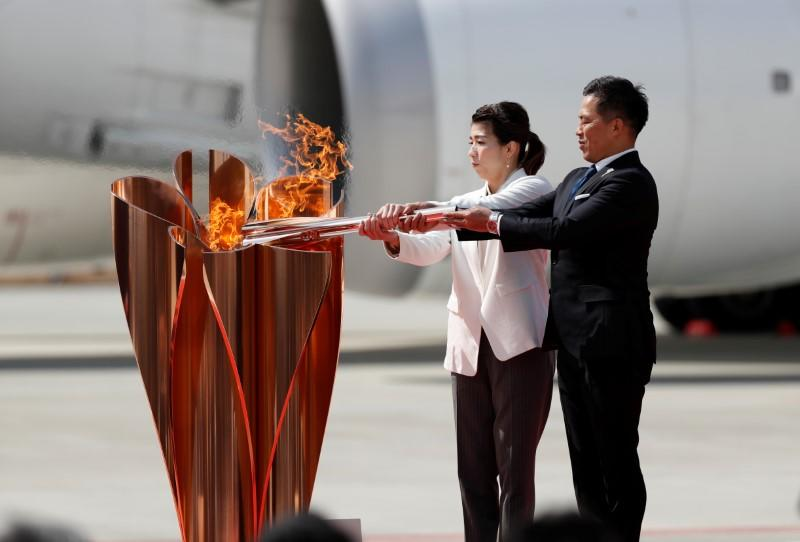 Crowds form at Olympic torch event in Japan despite coronavirus caution