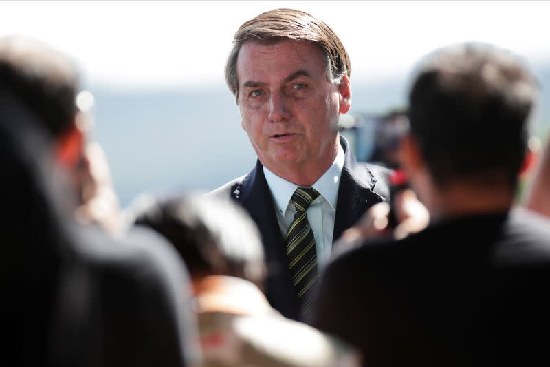 Brazil's President Jair Bolsonaro meets supporters as he leaves Alvorada Palace, as the spread of coronavirus disease (COVID-19) continues, in Brasilia