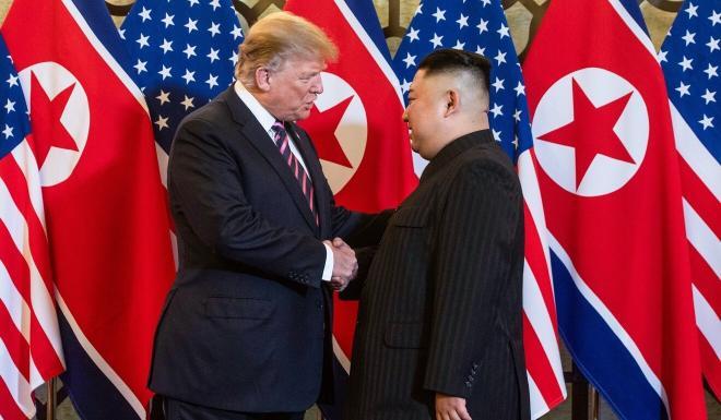 US President Donald Trump shakes hands with North Korean leader Kim Jong-un in Hanoi last year. Photo: AFP
