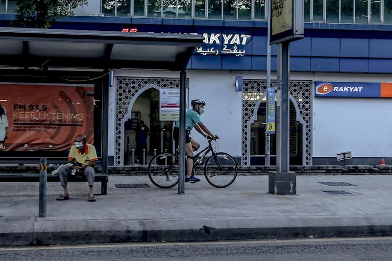 A man cycles along a quiet street in Kuala Lumpur March 25, 2020. — Picture by Firdaus Latif