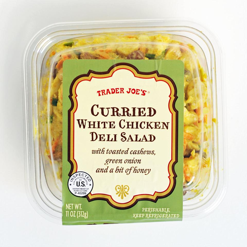 <p>In need of a filling and tasty lunch? This curried white chicken deli salad has toasted cashews, green onions, and a mouthwatering hint of honey. It's so good, you'll be inclined to eat the whole tub in one sitting. Are you ready?</p>