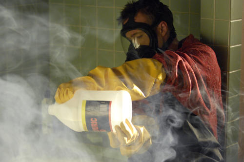 """This image released by AMC shows Jesse Pinkman, played by Aaron Paul, using acid to dissolve the body of drug dealer Emilio Koyama in the pilot episode of """"Breaking Bad."""" The series finale of the popular drama series aired on Sunday, Sept. 29.(AP Photo/AMC, Lewis Jacobs)"""