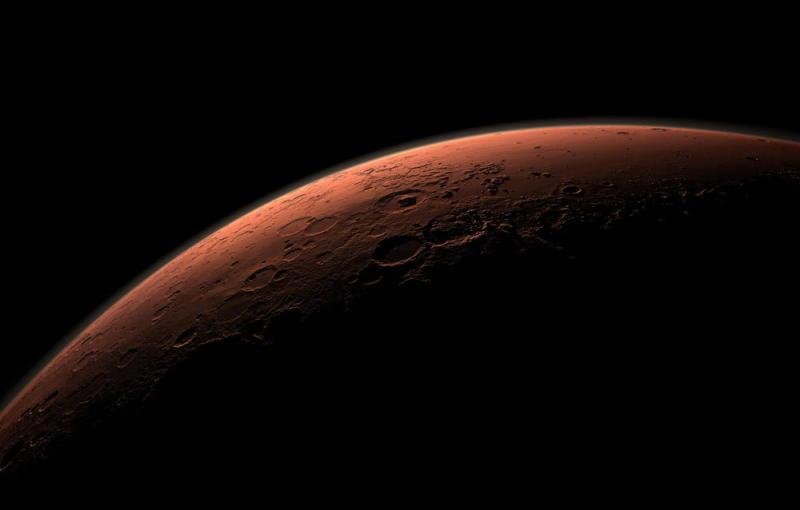 Liquid water ponds found under Mars ice