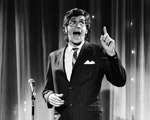"This Feb. 25, 1978 image released by NBCU Photo Bank shows Tom Davis during ""The Franken and Davis Show"" skit on ""Saturday Night Live."" Davis, a writer who worked with Al Franken to develop some of the most popular skits in the early years of ""Saturday Night Live"" died Thursday, July 19, 2012, of throat and neck cancer in New York. He was 59. (AP Photo/NBCU Photo Bank)"