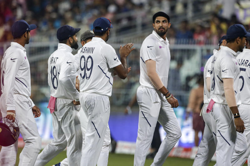 India's Ishant Sharma leaves the field for a tea break with other teammates during the second day of the second test cricket match between India and Bangladesh, in Kolkata, India, Saturday, Nov. 23, 2019. (AP Photo/Bikas Das)