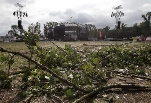 Fallen branches in front of the main stage at the festival campsite near Hasselt, 50 miles (80 kilometers) east of Brussels, Friday Aug.19, 2011. Five people died in a fierce thunderstorm on Thursday, that mangled tents and downed trees and scaffolding at the open-air music festival PukkelPop in Belgium. Organizers canceled the annual four-day festival. (AP Photo/Yves Logghe)