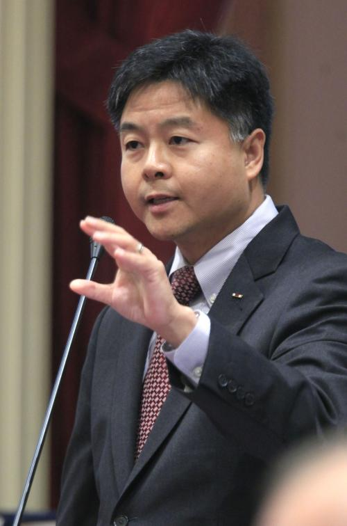 """FILE- This file photo taken Sept. 9, 2011, shows California State Sen. Ted Lieu , D-Torrance , as he speaks before the Senate at the Capitol in Sacramento, Calif. Lieu is considering calling for a boycott of Lowe's stores after the home improvement chain pulled its advertising from a reality show about Muslim-Americans. Calling the retail giant's decision """"naked religious bigotry,"""" Lieu said Sunday, Dec. 11, 2011, he would also consider legislative action if Lowe's doesn't apologize to Muslims and reinstate its ads. (AP Photo/Rich Pedroncelli, File)"""