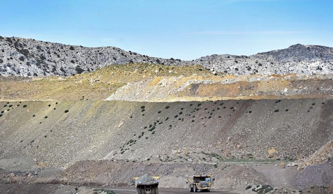 Trucks hauling ore from the rare earth mine in Mountain Pass, California. Photo: Reuters