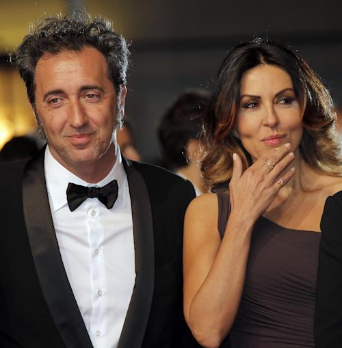 Director Paolo Sorrentino, left, and actress Sabrina Ferilli arrive for the screening of The Great Beauty at the 66th international film festival, in Cannes, southern France, Tuesday, May 21, 2013. (AP Photo/Lionel Cironneau)