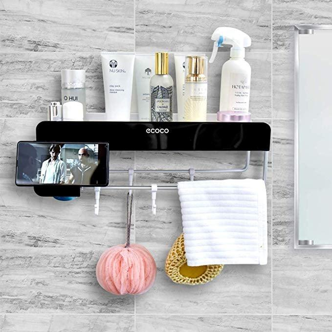 """<p>Yes, this <a href=""""https://www.popsugar.com/buy/She-Home-Bathroom-Wall-Mounted-Organizer-466871?p_name=She%27s%20Home%20Bathroom%20Wall%20Mounted%20Organizer&retailer=amazon.com&pid=466871&price=30&evar1=savvy%3Aus&evar9=46366430&evar98=https%3A%2F%2Fwww.popsugar.com%2Fphoto-gallery%2F46366430%2Fimage%2F46366661%2FPerfect-Your-Bathroom-Wall&list1=shopping%2Camazon%2Corganization%2Cshowers%2Cbathrooms&prop13=api&pdata=1"""" rel=""""nofollow"""" data-shoppable-link=""""1"""" target=""""_blank"""" class=""""ga-track"""" data-ga-category=""""Related"""" data-ga-label=""""https://www.amazon.com/SHES-HOME-Bathroom-Organizer-Organization/dp/B07PQZH6X1/ref=sr_1_44?crid=3HJT8AR87P4OX&amp;keywords=shower%2Borganizer&amp;qid=1562863641&amp;s=gateway&amp;sprefix=shower%2Borg%2Caps%2C193&amp;sr=8-44&amp;th=1"""" data-ga-action=""""In-Line Links"""">She's Home Bathroom Wall Mounted Organizer</a> ($30) even has a place to put your iPhone, if you dare to risk it.</p>"""