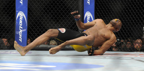EDS NOTE GRAPHIC CONTENT: Anderson Silva, right, of Brazil, screams after kicking Chris Weidman of Baldwin, N.Y., and injuring his leg during the UFC 168 mixed martial arts middleweight championship bout on Saturday, Dec. 28, 2013, in Las Vegas. Weidman won during the second round by a technical knock out after the kick by Silva. (AP Photo/David Becker)