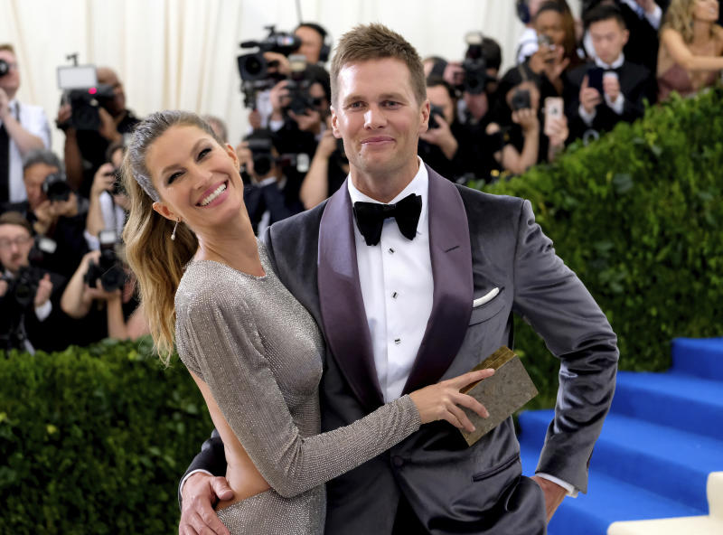 """FILE - In this May 1, 2017, file photo, Gisele Bundchen, left, and Tom Brady attend The Metropolitan Museum of Art's Costume Institute benefit gala celebrating the opening of the Rei Kawakubo/Comme des Garçons: Art of the In-Between exhibition in New York. Bundchen told """"CBS This Morning"""" in an interview that aired May 17, 2017, that Brady suffered a concussion last year. (Photo by Charles Sykes/Invision/AP, File)"""