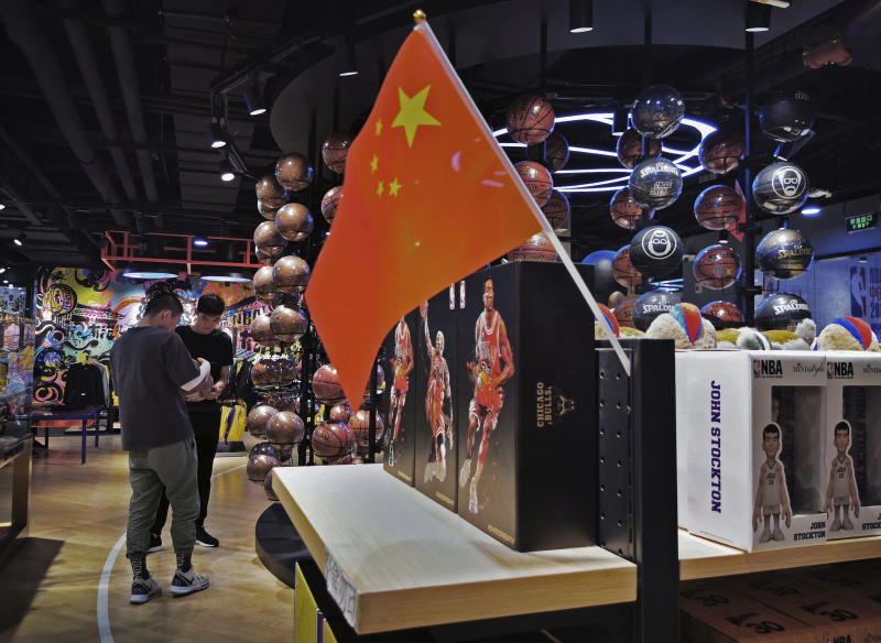 **IMAGE TAKEN WITH MOBILE PHONE CAMERA ** BEIJING, CHINA - OCTOBER 09: A Chinese flag is seen placed on merchandise in the NBA flagship retail store on October 9, 2019 in Beijing, China. The NBA is trying to salvage its brand in China amid criticism of its handling of a controversial tweet that infuriated the government and has jeopardized the leagues Chinese expansion. The crisis, triggered by a Houston Rockets executives tweet that praised protests in Hong Kong, prompted the Chinese Basketball Association to suspend its partnership with the league. The backlash continued with state-owned television CCTV scrapping its plans to broadcast pre-season games in Shanghai and Shenzhen, and the cancellation of other promotional fan events. The league issued an apology, though NBA Commissioner Adam Silver angered Chinese officials further when he defended the right of players and team executives to free speech. China represents a lucrative market for the NBA, which stands to lose millions of dollars in revenue and threatens to alienate Chinese fans. Many have taken to Chinas social media platforms to express their outrage and disappointment that the NBA would question the countrys sovereignty over Hong Kong which has been mired in anti-government protests since June.(Photo by Kevin Frayer/Getty Images)