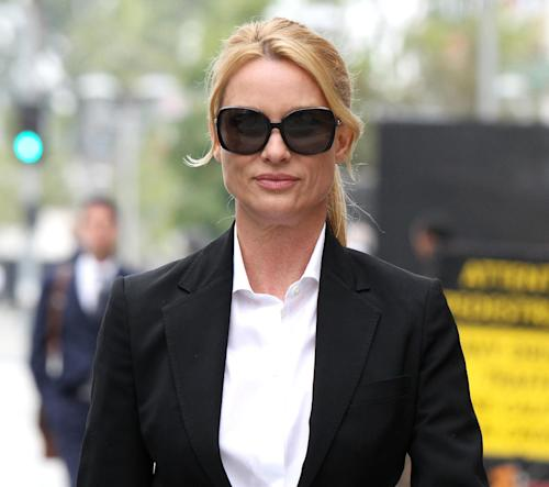 """FILE - In this March 13, 2012 file photo, """"Desperate Housewives"""" star, Nicollette Sheridan arrives at court in Los Angeles. An appeals court in Los Angeles ruled Thursday August 16, 2012 that Sheridan is not entitled to a new trial on her claim that she was wrongfully fired from the series """"Desperate Housewives,"""" but that she should be allowed to pursue a claim she was retaliated against for complaining about an unsafe work condition. (AP Photo/Nick Ut, file)"""