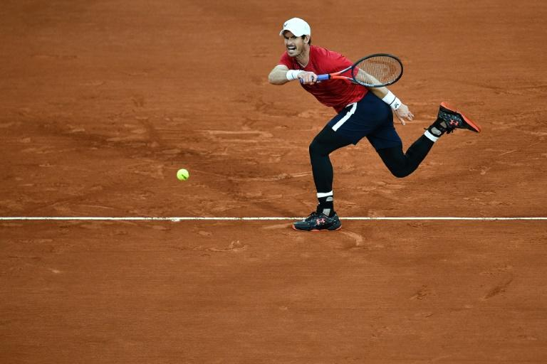 Murray says 'difficult' to be former self after Wawrinka rout