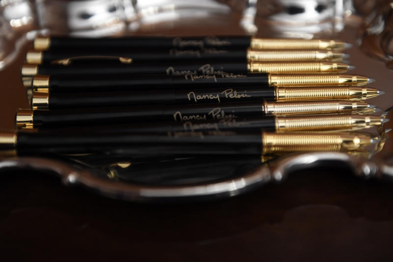 The pens that House Speaker Nancy Pelosi of Calif., will use to sign the resolution to transmit the two articles of impeachment against President Donald Trump to the Senate for trial on Capitol Hill in Washington, Wednesday, Jan. 15, 2020. . (AP Photo/Susan Walsh)
